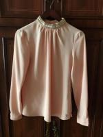 Продам блузку персикового цвета
