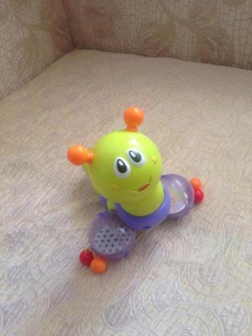 Продам музыкальную каталку игрушку - 1